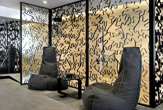 Moooi beanbag chairs by Marcel Wanders in front of a bespoke metal screen by Reform.