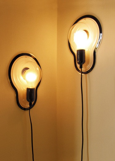 Designer bulb lights by Droog crawling up a wall.