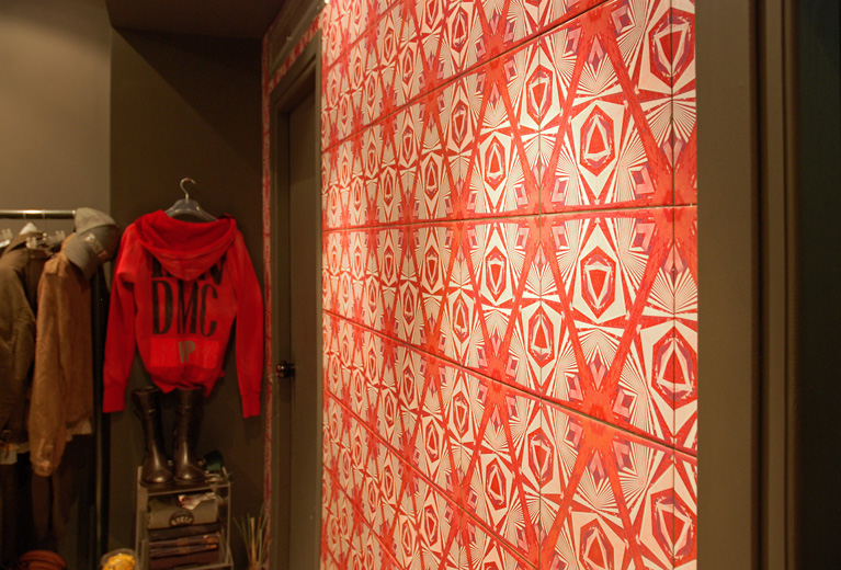 A feature wall in Snatch fashion boutique using red fractal tiles.