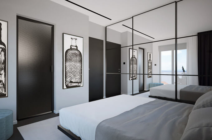 A modern masculine bedroom with a floating bed, mirrored wardrobes and black doors.