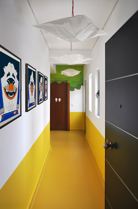 A playful contemporary corridor of a pediatric clinic using color blocking.