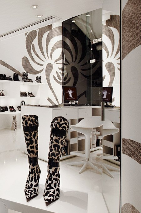 The chic interior of a boutique with an elegant white and brown color scheme.