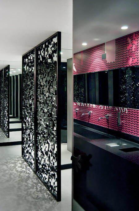 A modern pink and black bathroom.