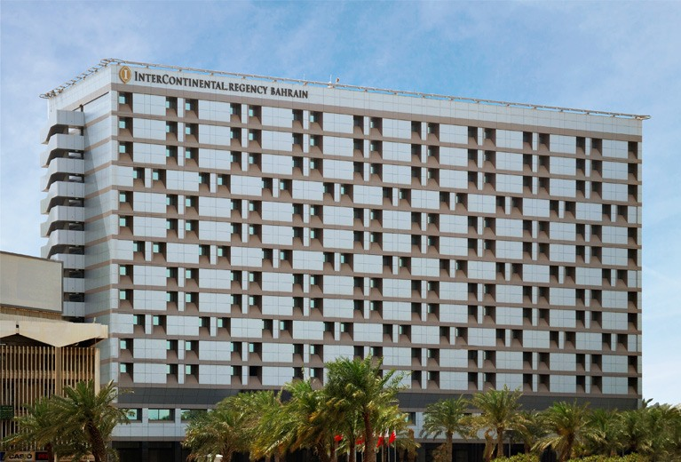 The new facade of the InterContinental Hotel in Bahrain using composite aluminum panel cladding in a two-tone pattern.