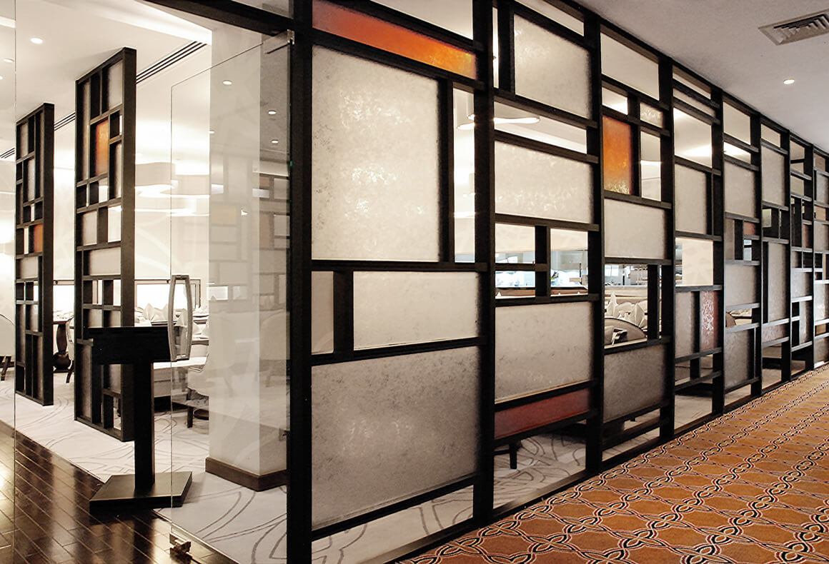 A geometric partition wall with frosted panels forming an impressive facade for the InterContinental Legendz restaurant.