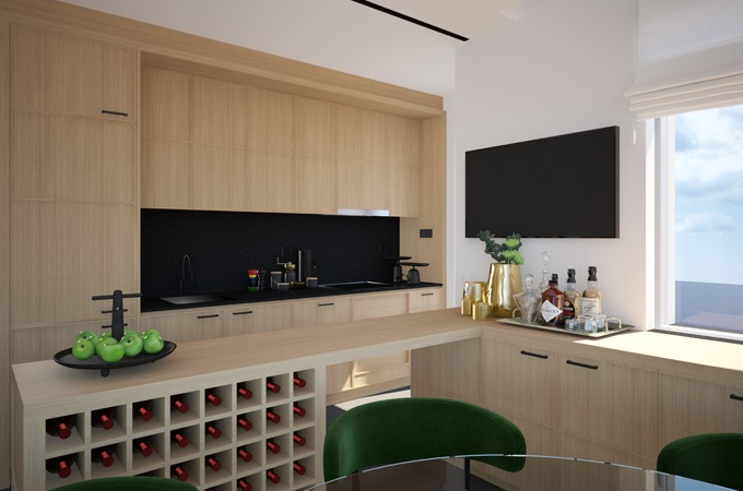 A modern kitchen with a black marble counter and oak cabinets, breakfast bar and wine rack.