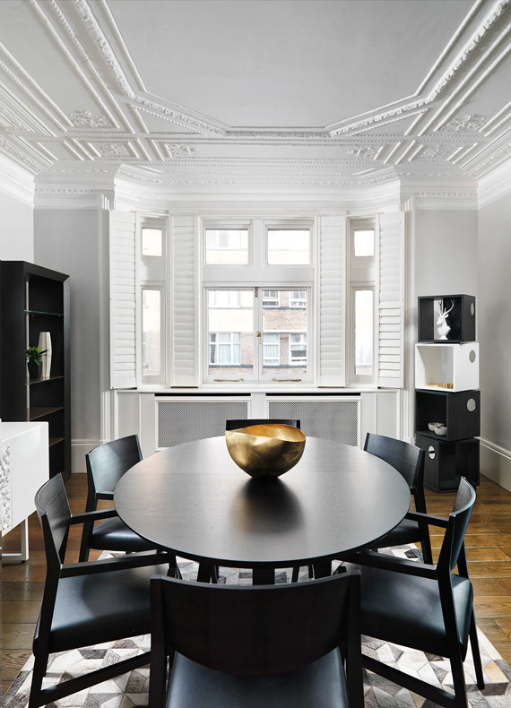 A modern meets classic dining area with a concise neutral colour palette, contemporary furniture and gold accents.