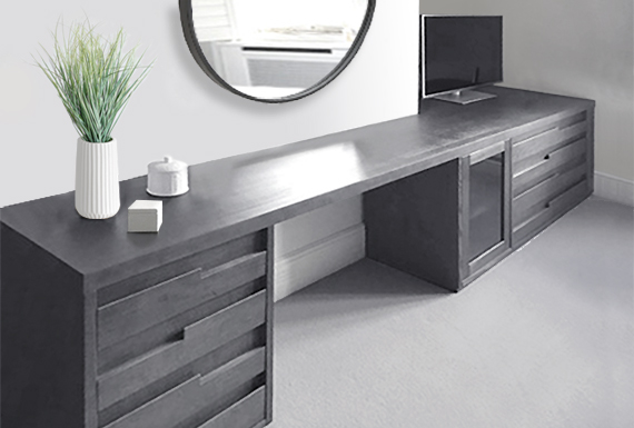 A custom-made sideboard in grey stained oak with an integrated dressing table.