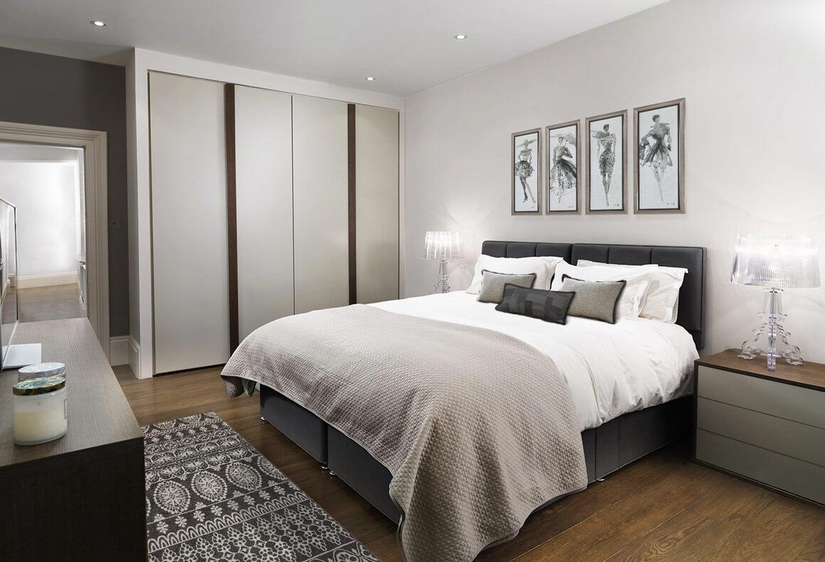 An elegant bedroom in a neutral color scheme of taupe, beige, tan, grey and brown.