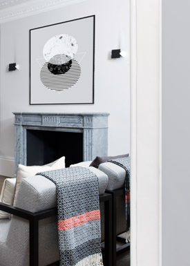 A warm grey living room interior featuring a classic fireplace and contemporary decor.