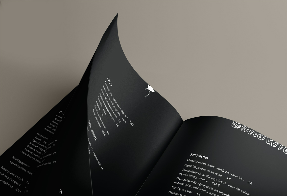 Nest Restaurant menu design using Gmund leather textured paper with white writing on a black background.