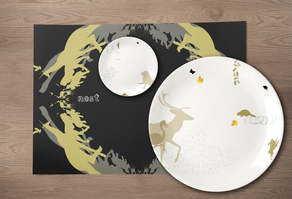 A restaurant table setting with a branded placemat and two custom printed porcelain plates.