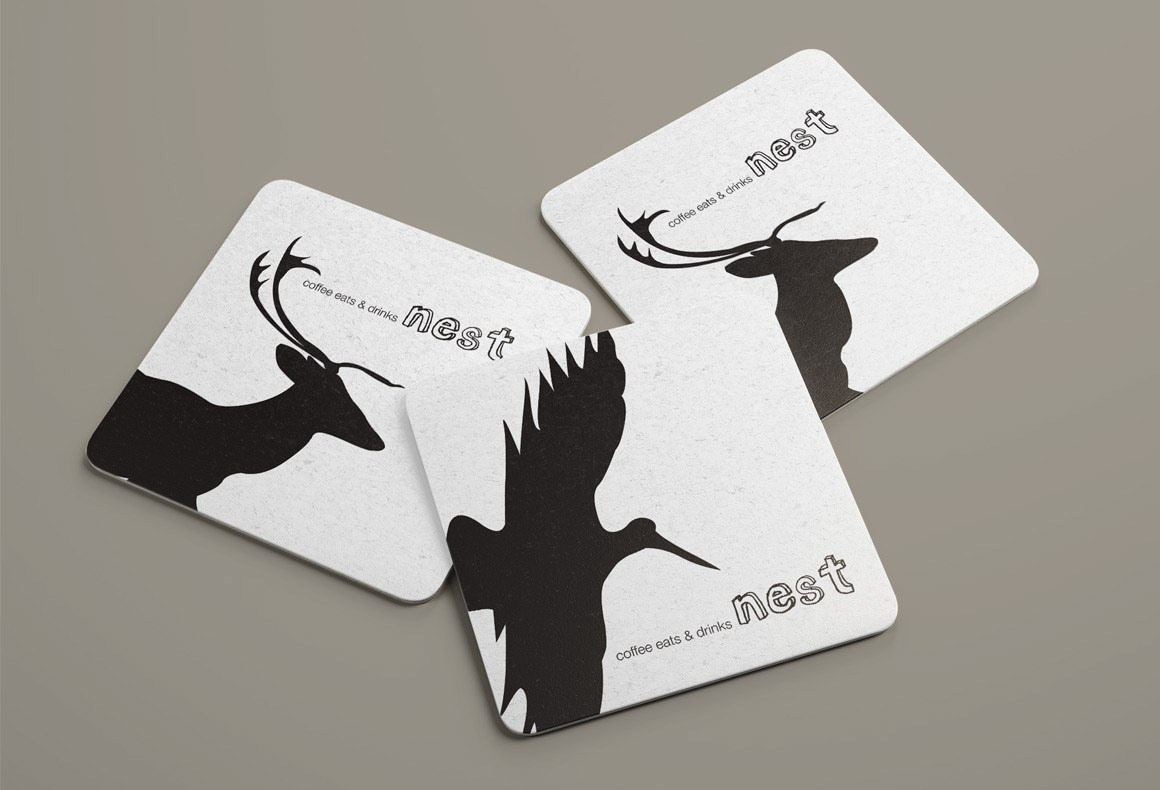 Three coasters designed with black animal silhouettes and the 3D logotype of Nest Restaurant.