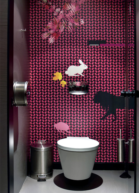 A playful custom wallpaper in pink and black for the restrooms of Nest Restaurant.