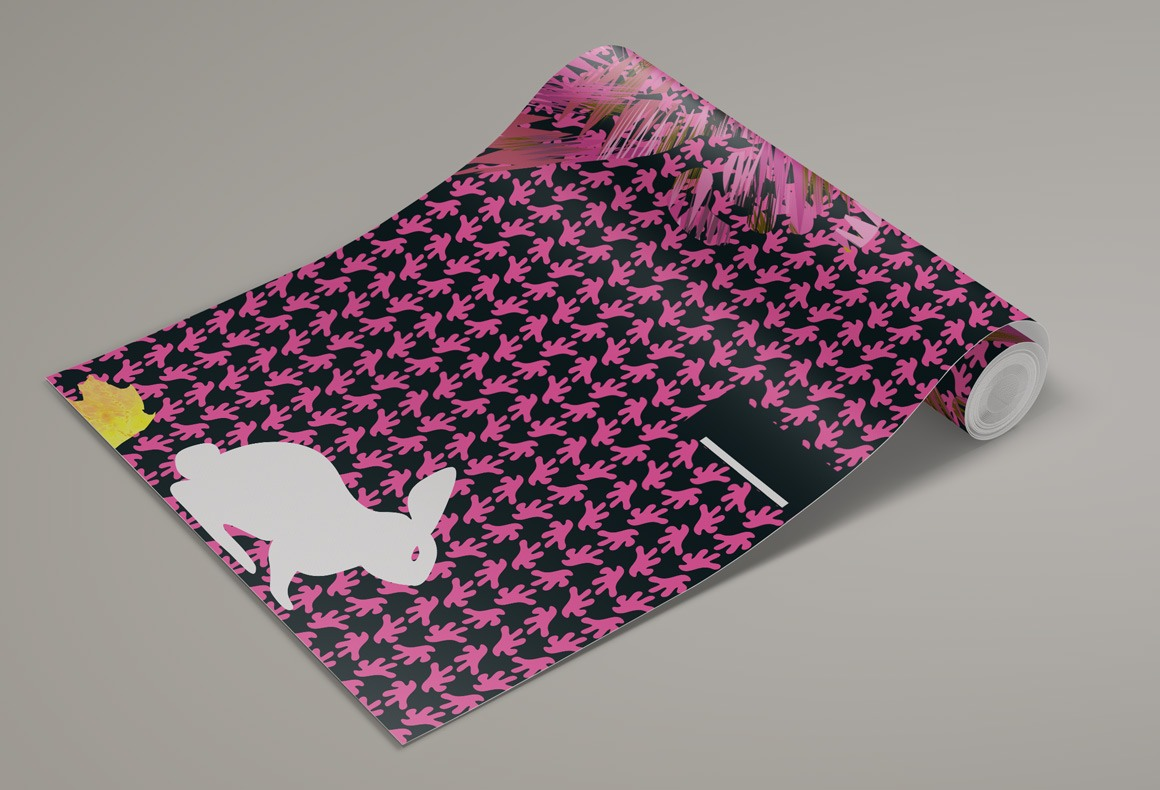 A custom designed wallpaper with a white bunny over a fuchsia and black pattern background.