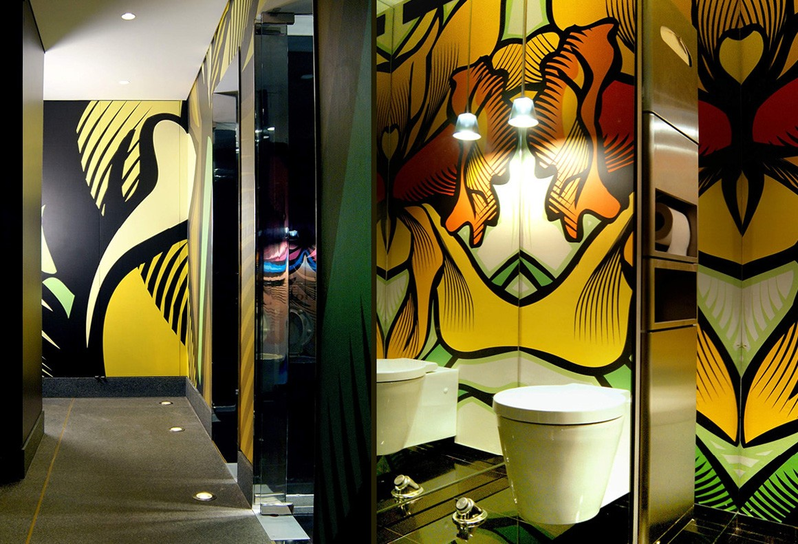 Wall illustrations for commercial restrooms using bold enlarged flowers.
