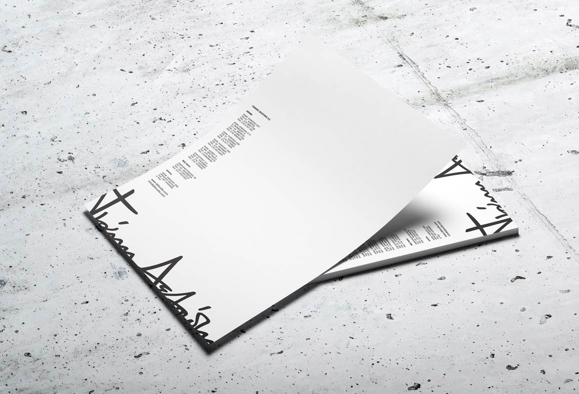 Letterheads with an oversized trimmed logo for Deloudis minimalist brand identity.