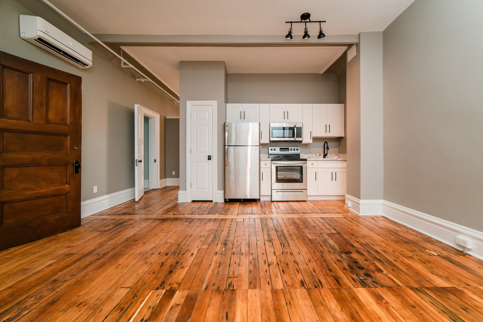 interior photo of kitchen space with hardwood floors