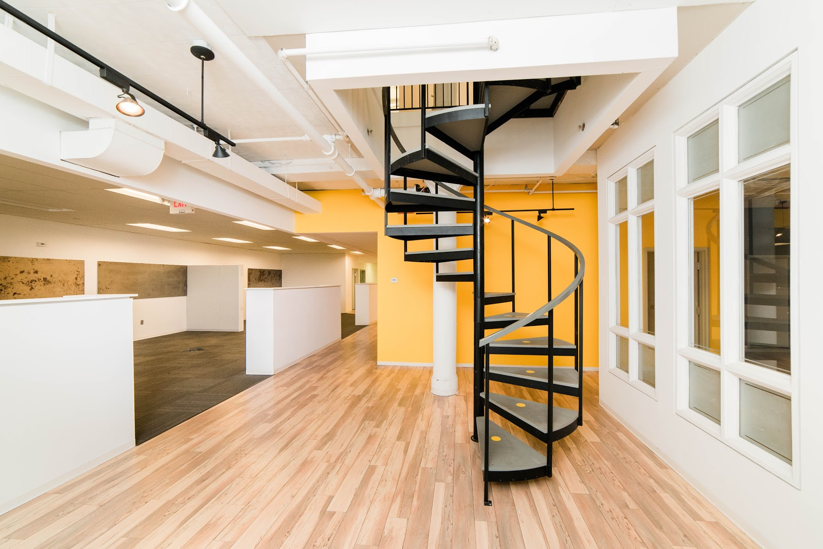 interior photo of office space with spiral staircase