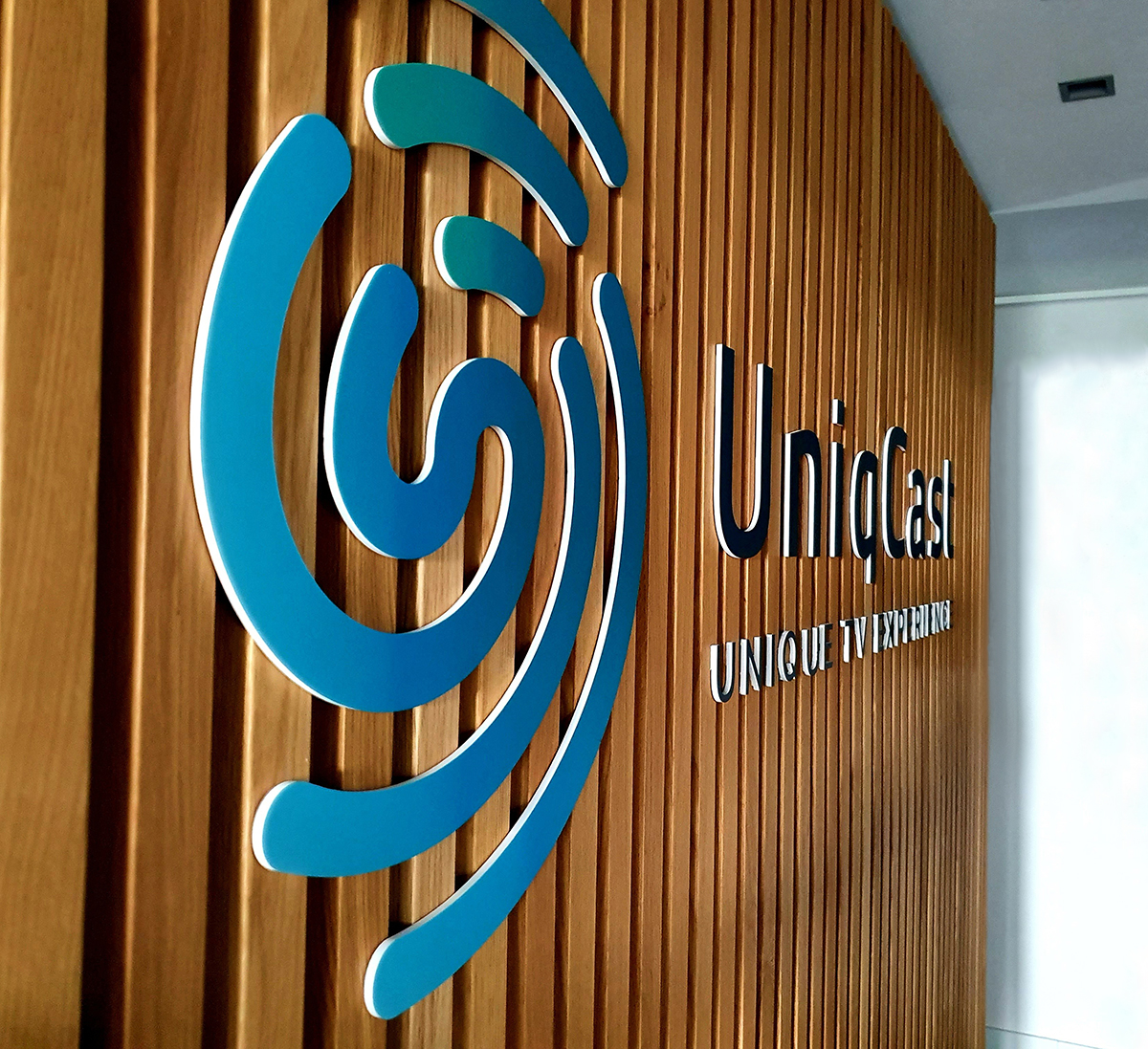 UniqCast Turnkey Solution logo in office