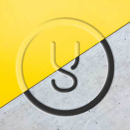 A large circle with the letter 'Y' in the middle, against a diagonal split backdrop of concrete and bright yellow