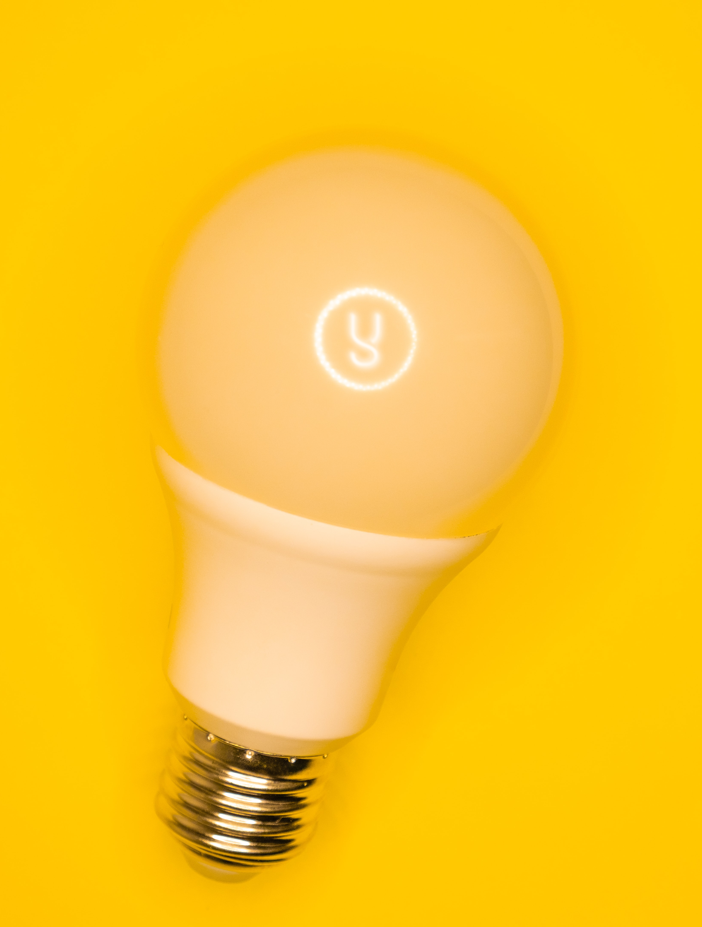 An image of a light bulb with an illuminated letter 'Y' in the middle of the light bulb, against a yellow background.