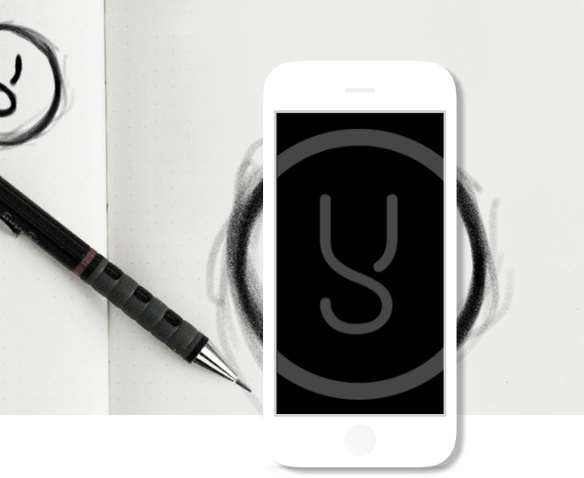 """Black and white image of an iPhone over a hand drawn circle. On the left of the photo lays a mechanical pencil and in the top left there is a half illustration of the letter """"Y""""."""