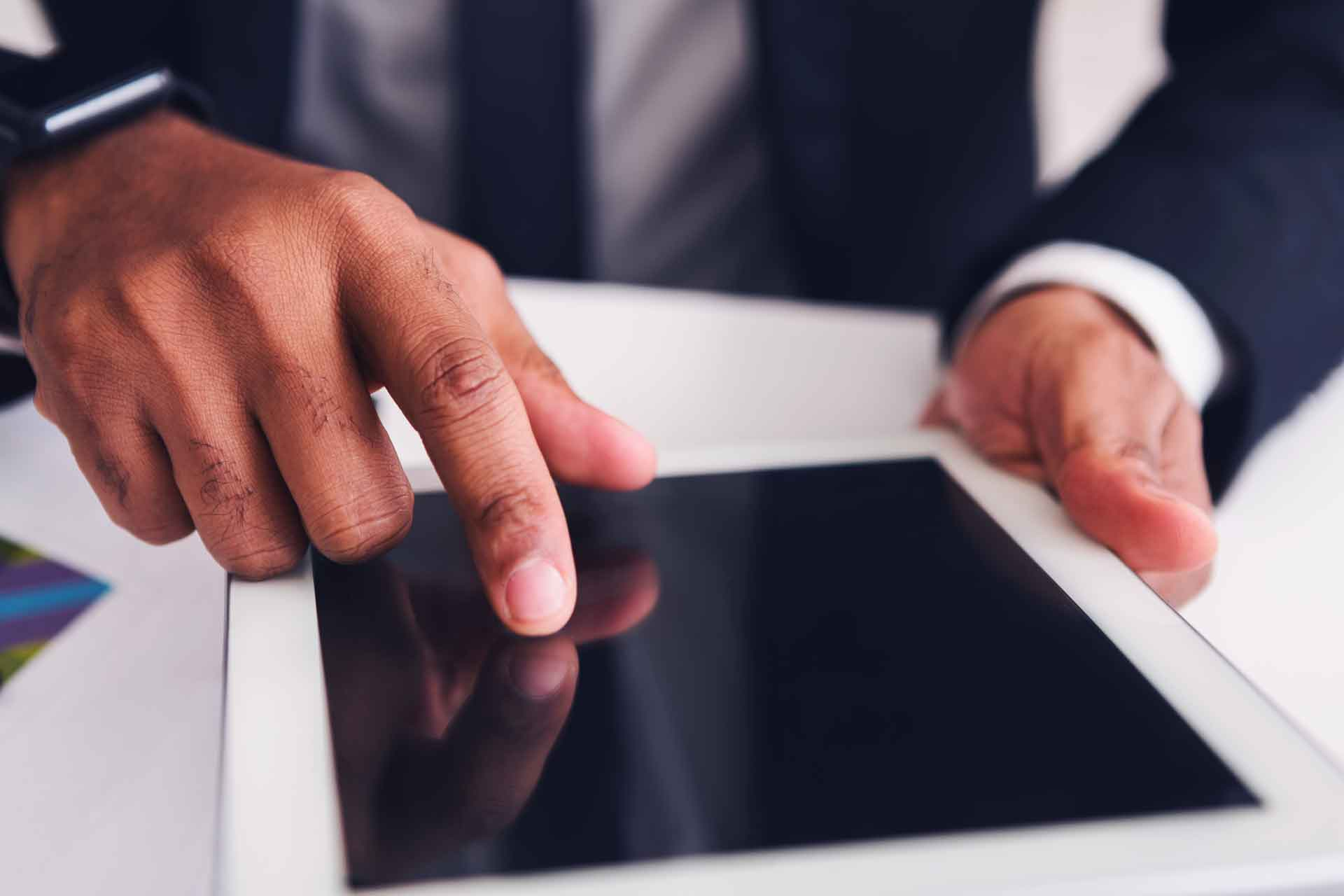 Modern businessman using a tablet