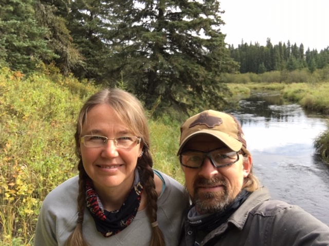 A selfie of Lyndon and Carolyn Gliege next to a creek