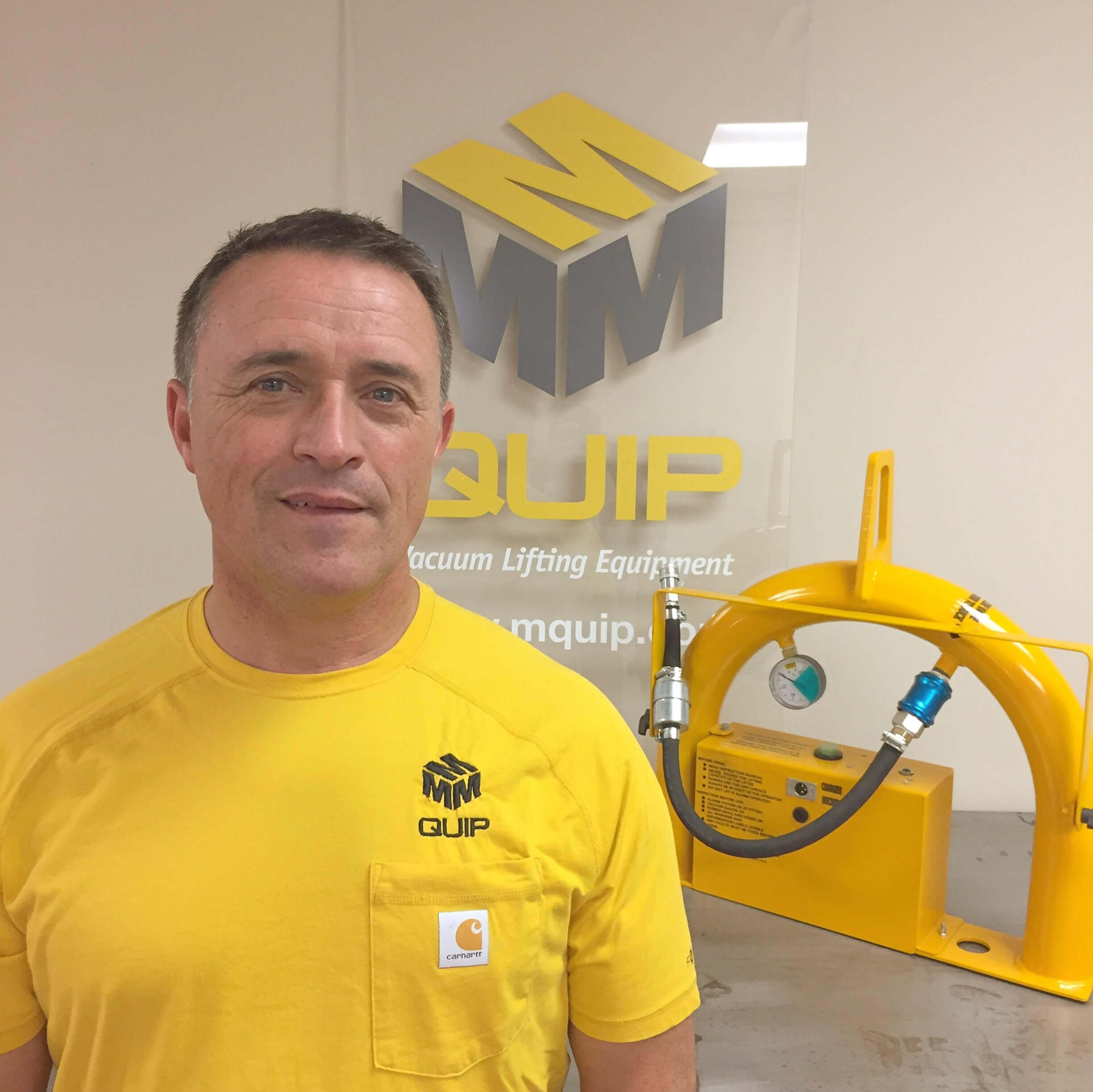 James, president at MQUIP, with the original Mini vacuum lifter.