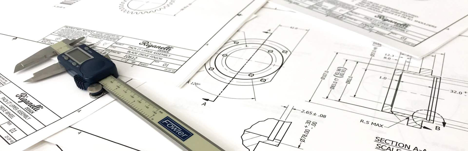 Technical drawings with digital calipers.