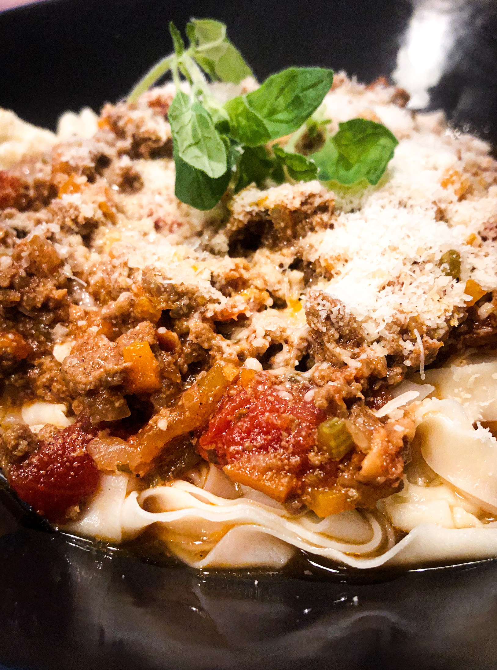 Homemade pasta with simmer-bolognese