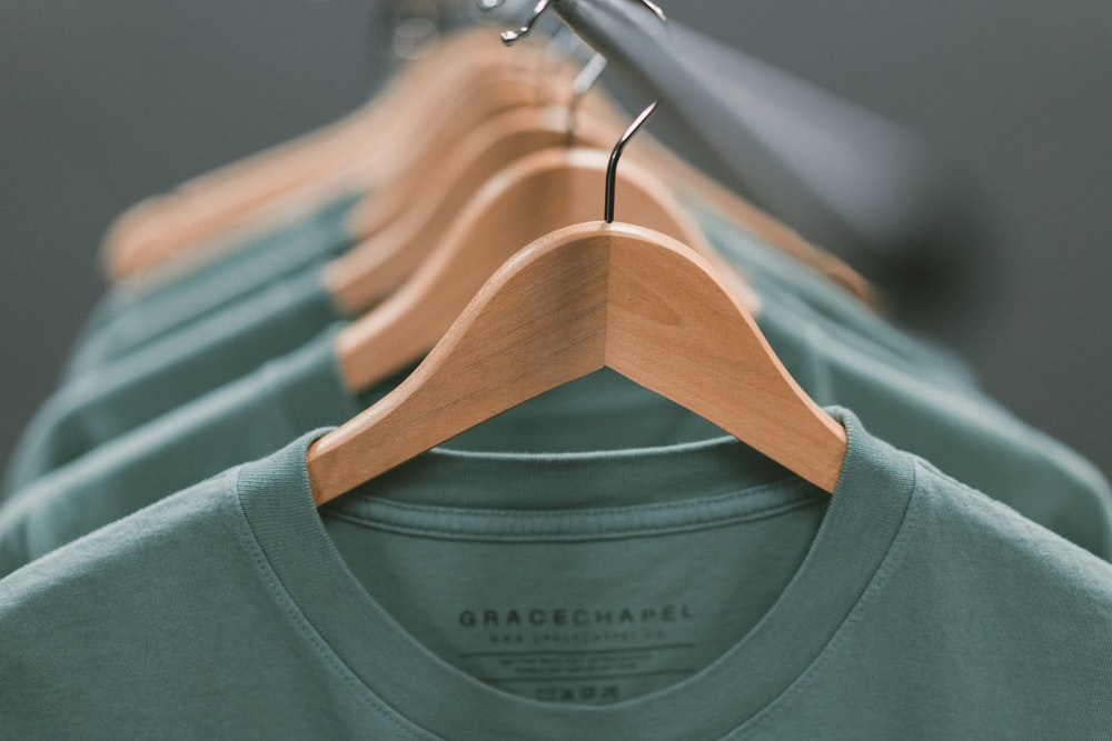 selective focus photography of green crew-neck shirt