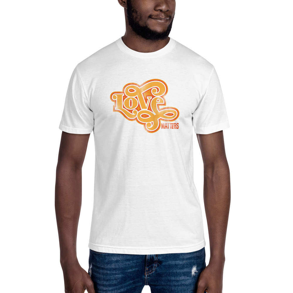 """Treat yourself with this lightweight t-shirt. It has a slim fit and is made from a mix of cotton and polyester. Not only will your shirt have a well-worn feel to it, but it will also wrinkle less and require little to no ironing. What's more, it stops the garment from shrinking, so it will last for longer.  • 50% ring-spun and combed cotton, 50% polyester • 7/8"""" (2.22 cm) seamed crew neck collar • 1"""" (2.54 cm) double-needle bottom hem • 1"""" (2.54 cm) blind-stitch sleeve hem • Shoulder-to-shoulder tape • Slim fit • Blank products stocked in the US are made in USA • Blank products stocked in the EU are sourced worldwide"""
