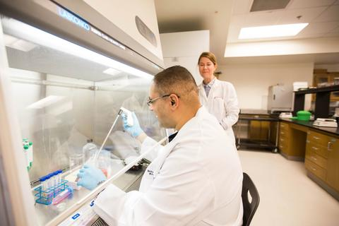 Bilal working in the lab with his partner Dr. Elizabeth Brandon.