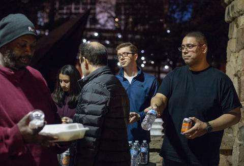 Bilal handing out drinks at the R U Hungry event.