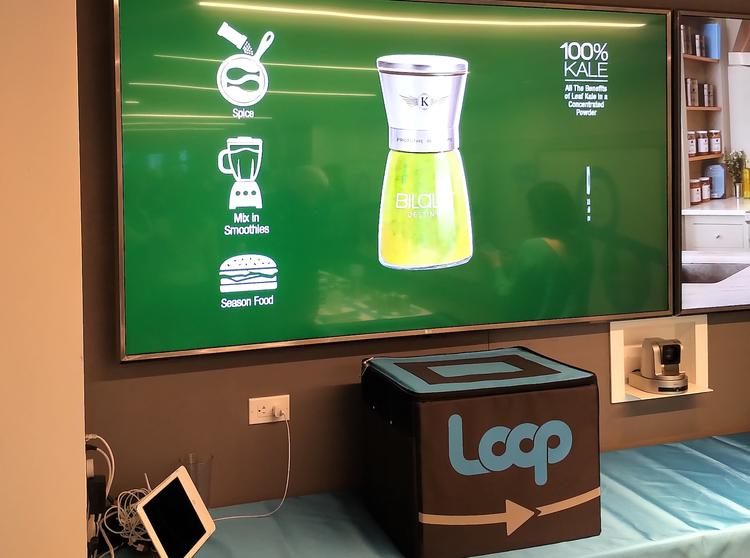 Image of the EasyKale shaker on a screen above a Loop display table.