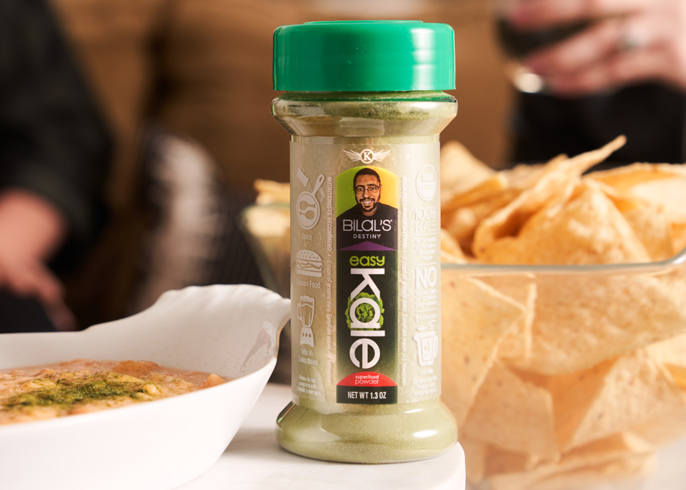 Bilal's EasyKale shaker sitting on a table surrounded by chips and dip.