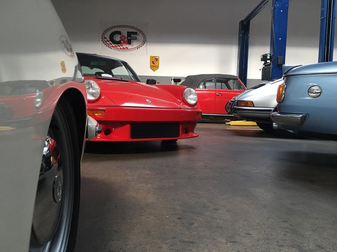 red porche in garage