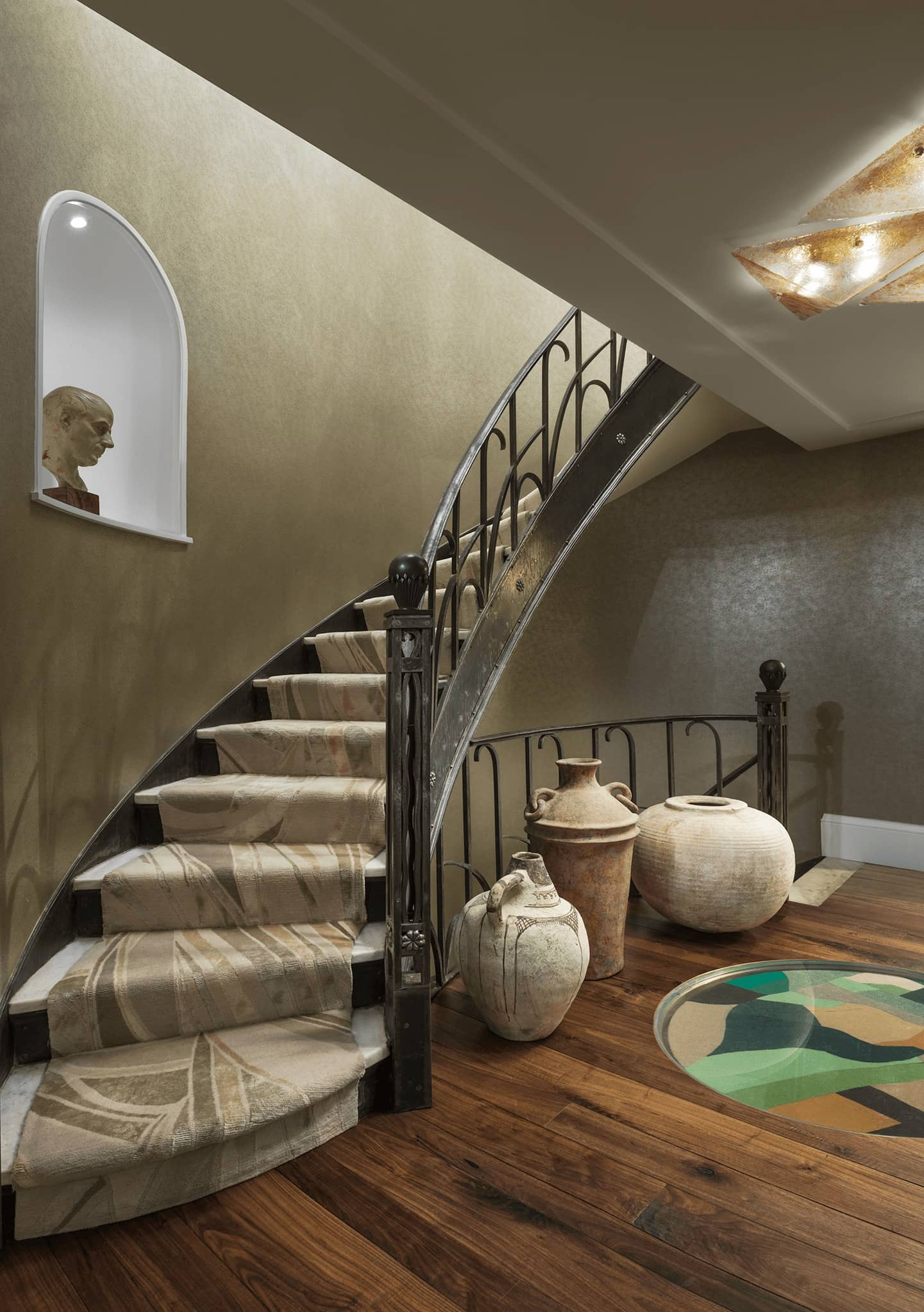 Staircase at 7 Park Avenue, decorated with several antique vases.