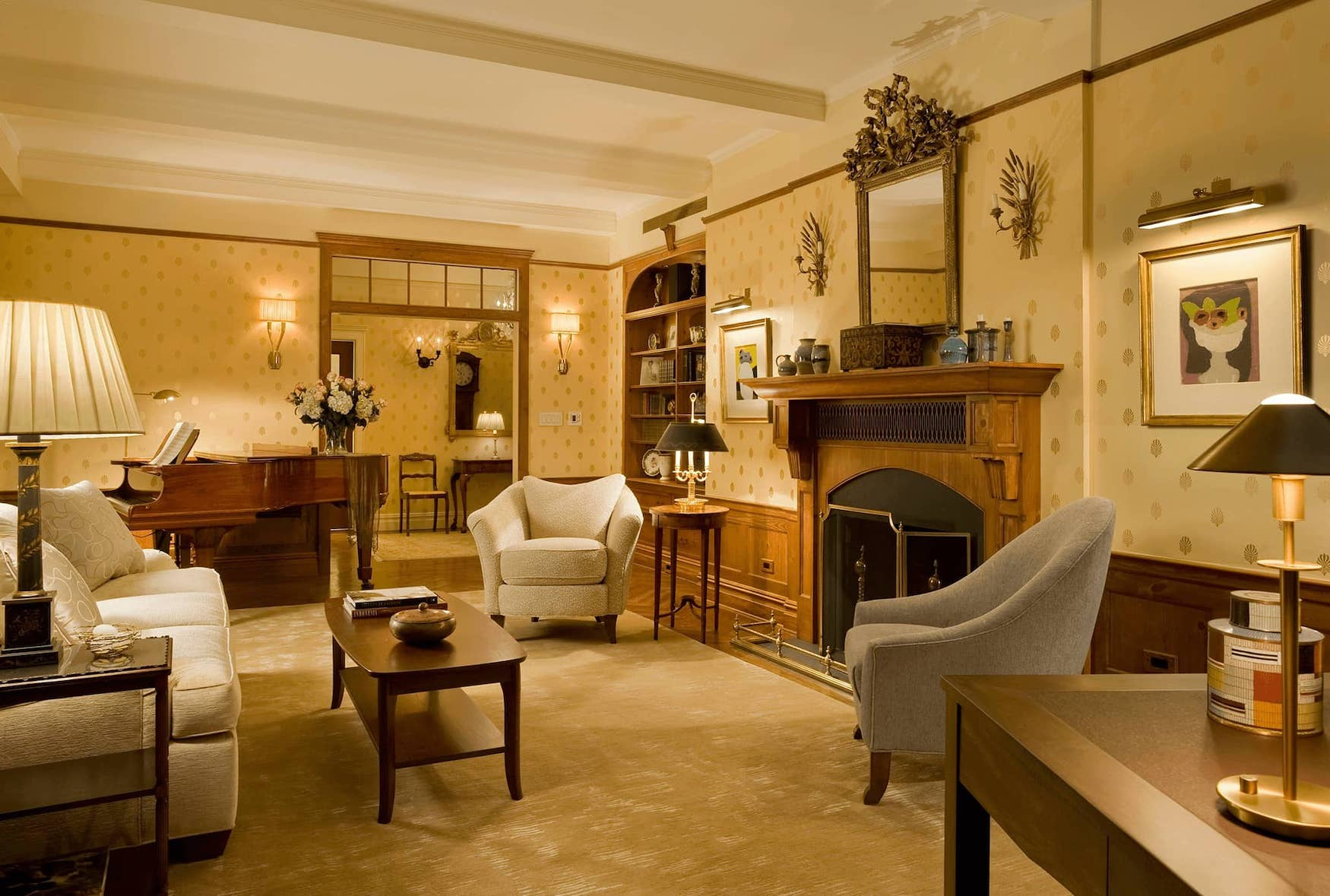 Living room with fireplace and grand piano at 101 Central Park West.