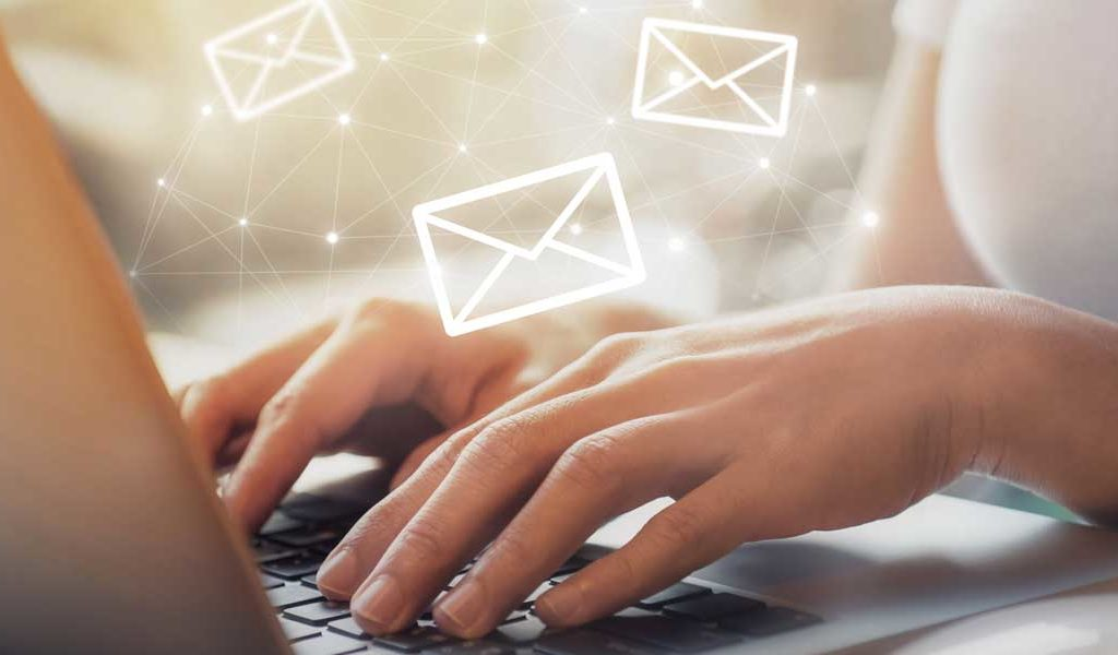 Person looking emails containing email attacks on her laptop
