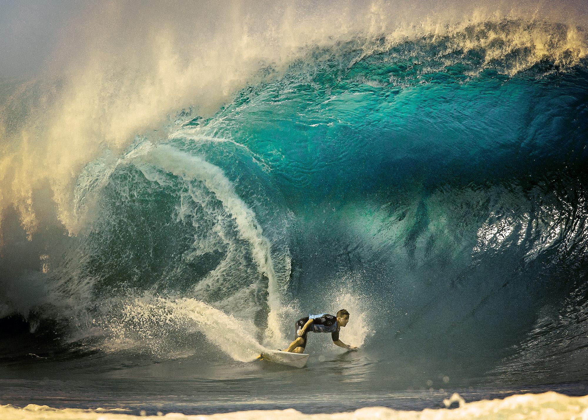Man turning on surfboard