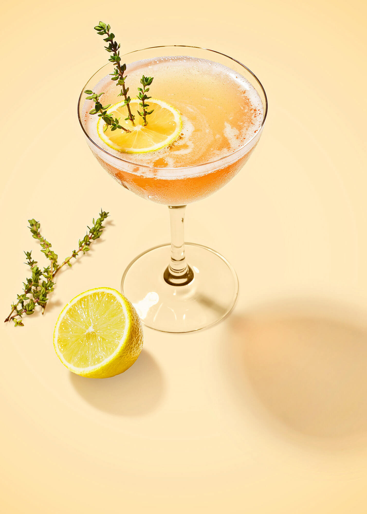 Gin cocktail with lemon garnish