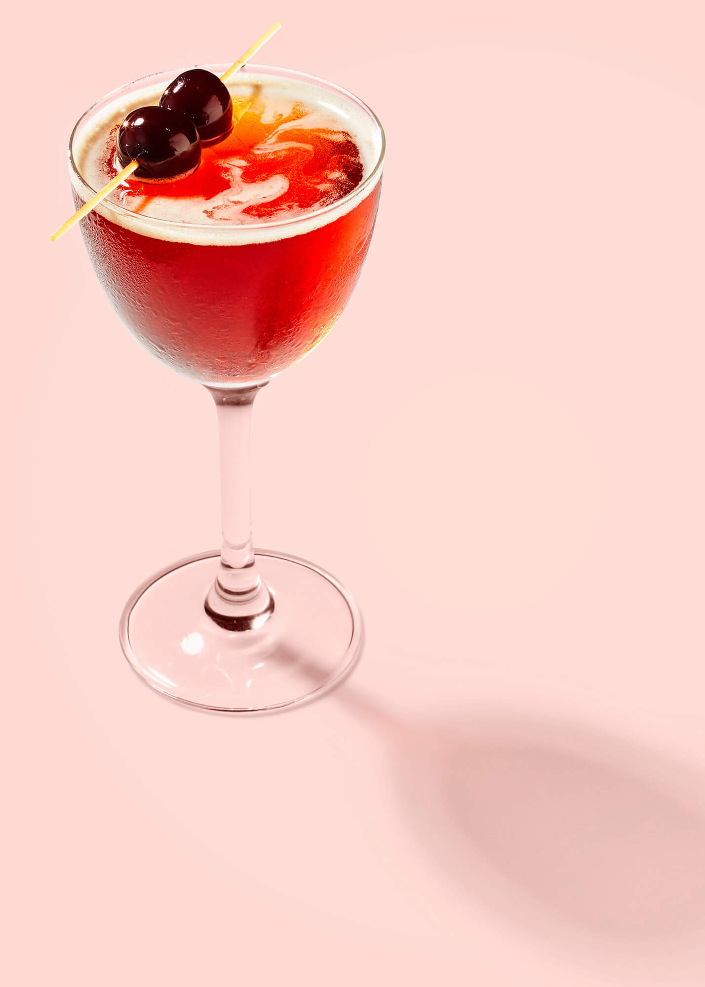 Manhattan cocktail with cherries