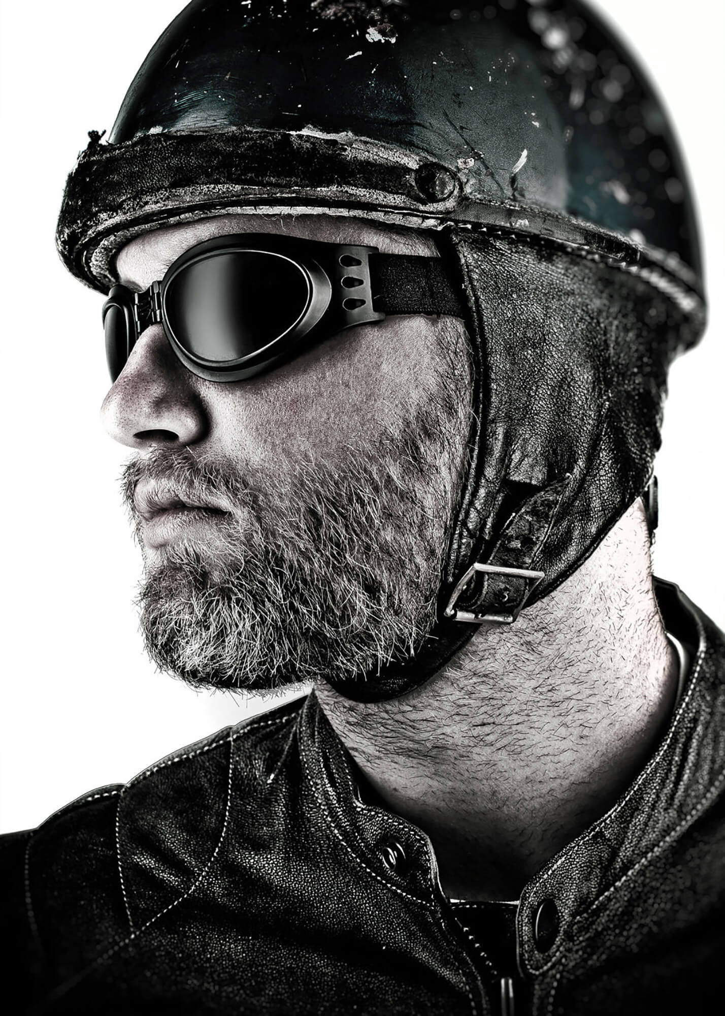 Studio portrait of man in motorcycle helmet