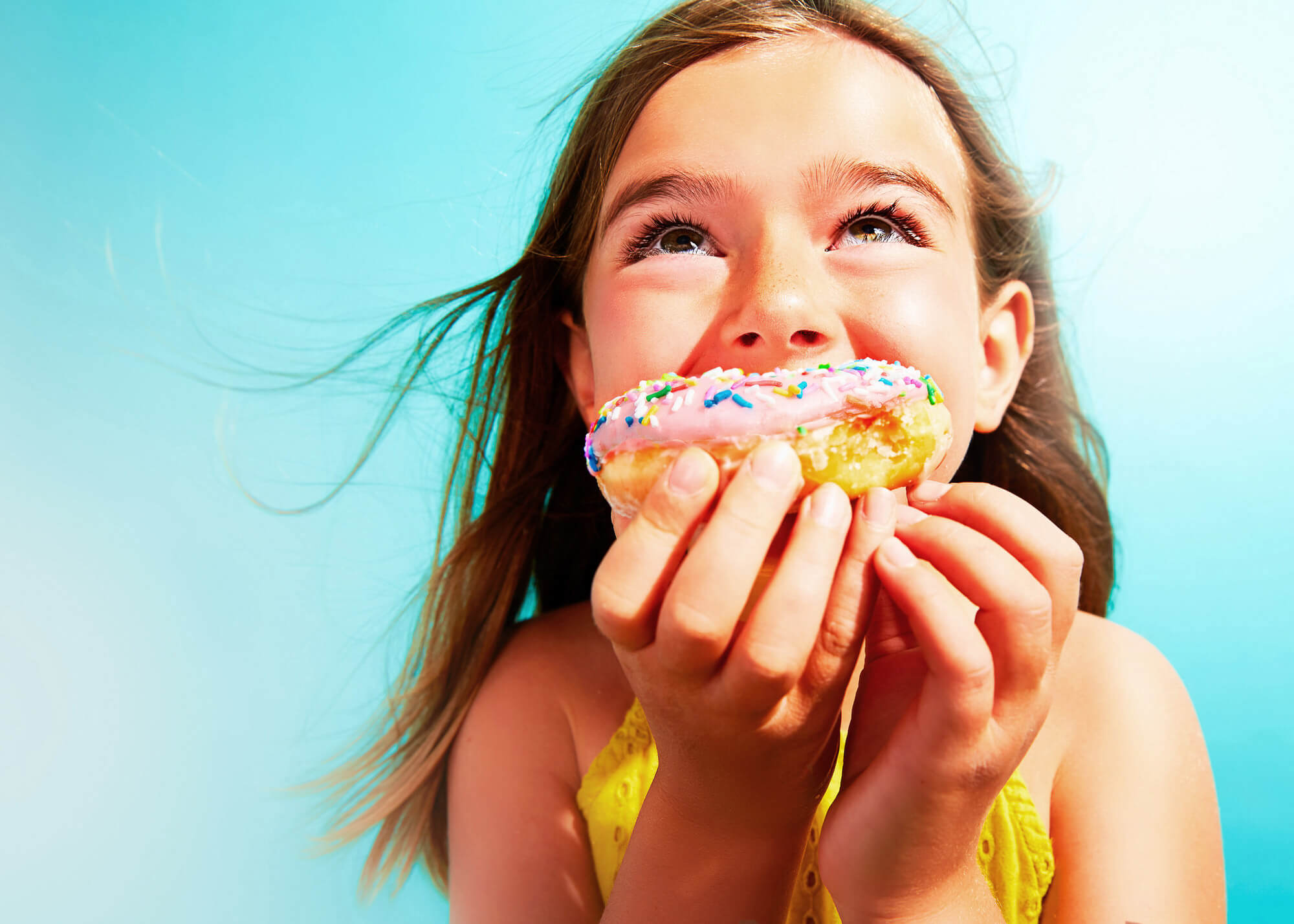 Portrait of young girl with donut