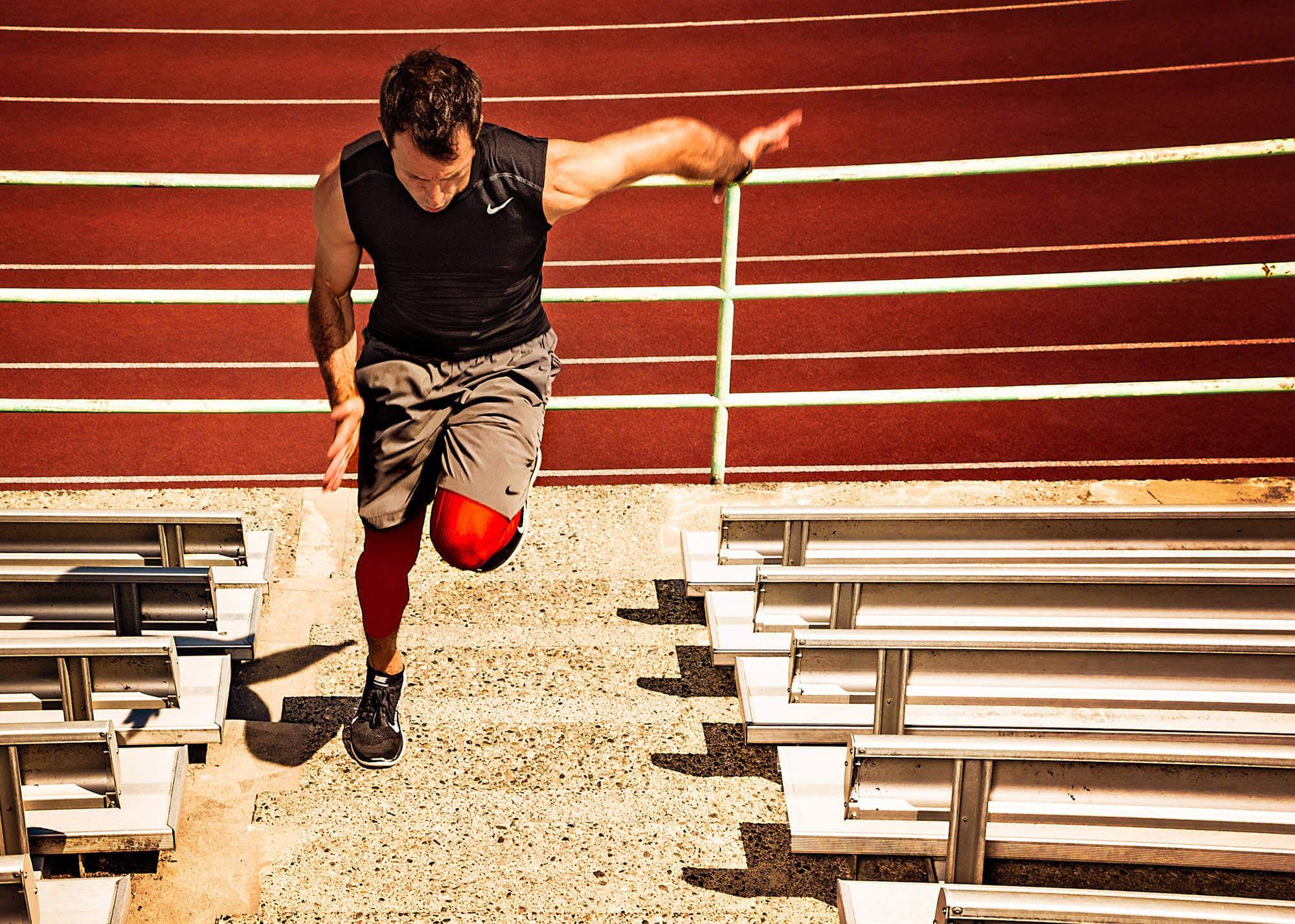 Athlete sprinting up stadium steps