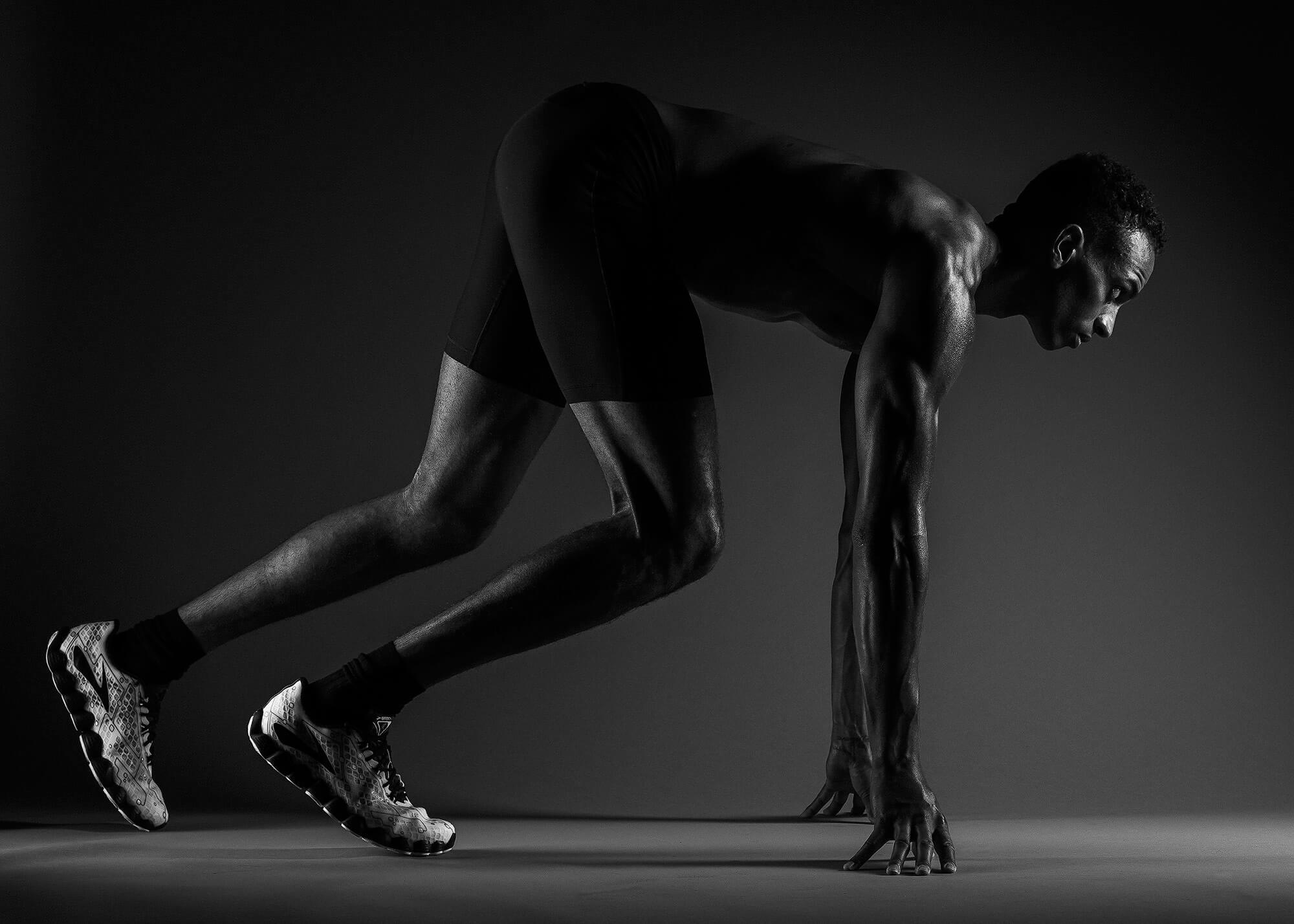 Track athlete posing in start position