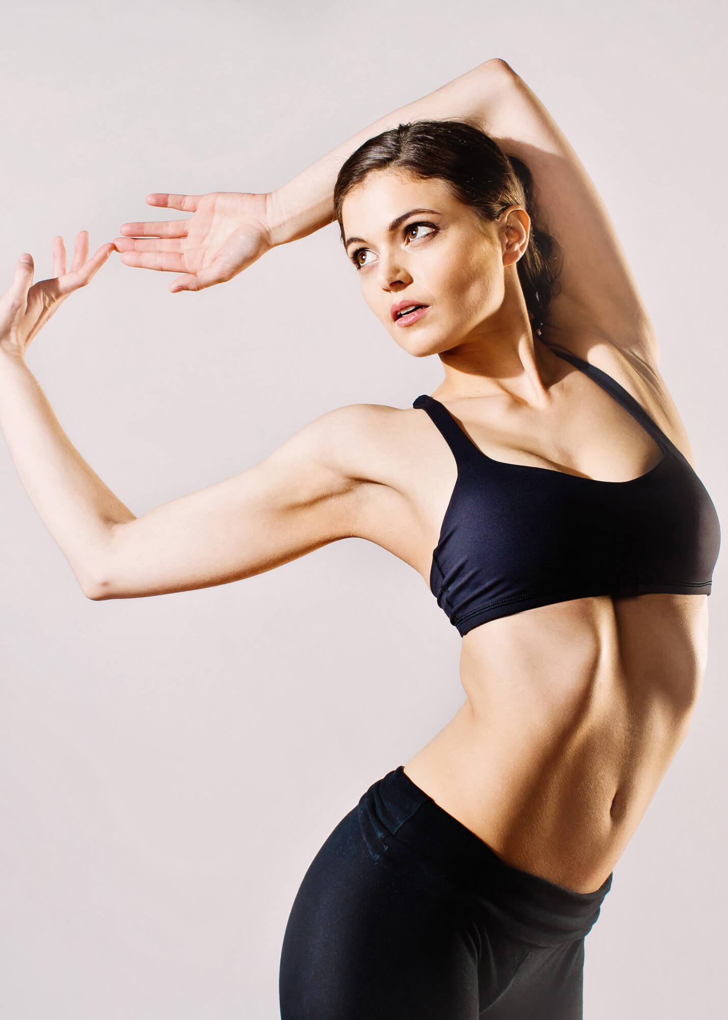 Fitness model in dance pose